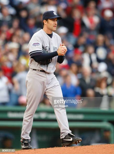Mike Mussina of the New York Yankees paces the mound in the sixth inning during the game against the Boston Red Sox at the Fenway Park on April 12,...