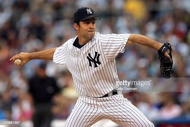 Mike Mussina of the New York Yankees pitches to the New York Mets at Yankee Stadium on June 30 2006 in Bronx New York