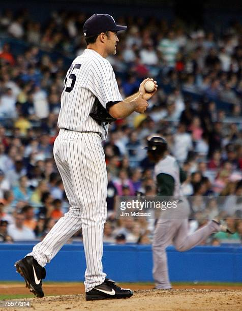 Mike Mussina of the New York Yankees reacts after surrendering a two-run home run to B.J. Upton of the Tampa Bay Devil Rays during the third inning...