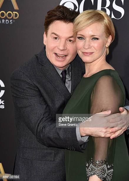 Mike Myers and Kelly Tisdale arrives at the 18th Annual Hollywood Film Awards at the Hollywood Palladium on November 14 2014 in Hollywood California
