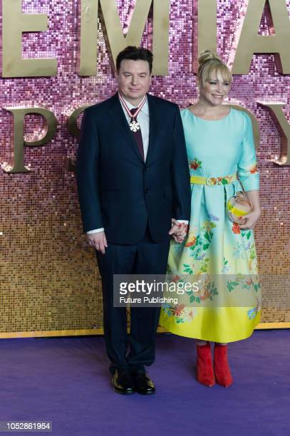Mike Myers and Kelly Tisdale attend the World Premiere of 'Bohemian Rhapsody' at the SSE Arena Wembley in London October 23 2018 in London United...