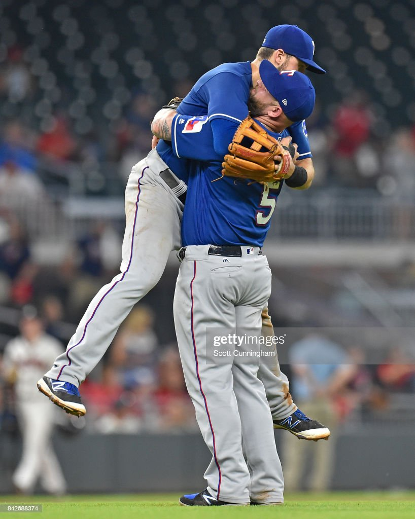 Mike Napoli #5 and Joey Gallo #13 (obscured) of the Texas Rangers celebrate after the game against the Atlanta Braves at SunTrust Park on September 4, 2017 in Atlanta, Georgia.
