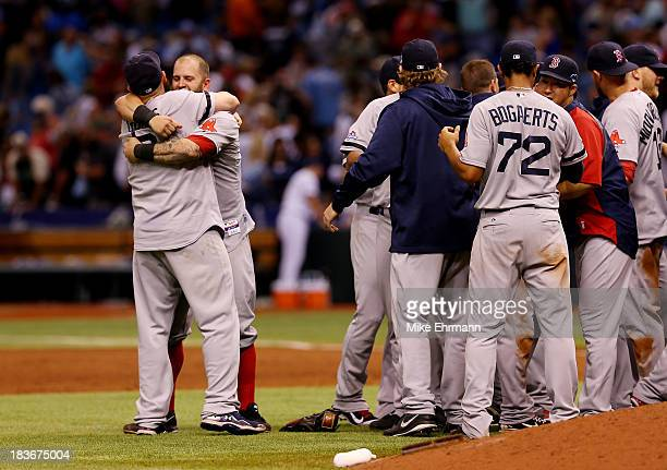 Mike Napoli and Jonny Gomes of the Boston Red Sox celebrate with teammates after defeating the Tampa Bay Rays 31 in Game Four of the American League...