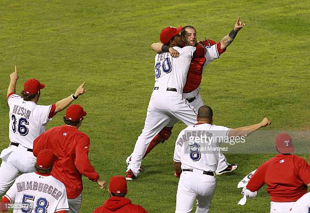 Mike Napoli and Neftali Feliz of the Texas Rangers celebrate winning Game Six of the American League Championship Series 15-5 against the Detroit...