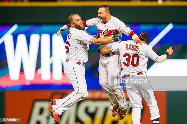 Mike Napoli and Tyler Naquin celebrate with Jason Kipnis of the Cleveland Indians after Kipnis hit a walkoff single to defeat the Minnesota Twins at...