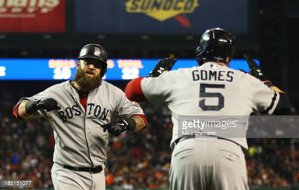 Mike Napoli celebrates his second inning solo homerun with Jonny Gomes of the Boston Red Sox during Game Five of the American League Championship...
