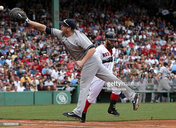 Mike Napoli is safe at first on third baseman Mark Reynolds's throwing error to New York Yankees first baseman Lyle Overbay in the second inning The...