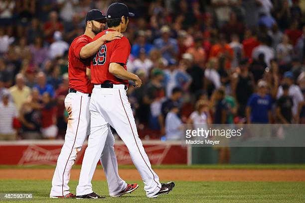 Mike Napoli of the Boston Red Sox and Koji Uehara celebrate after their 75 win over the Tampa Bay Rays at Fenway Park on July 31 2015 in Boston...