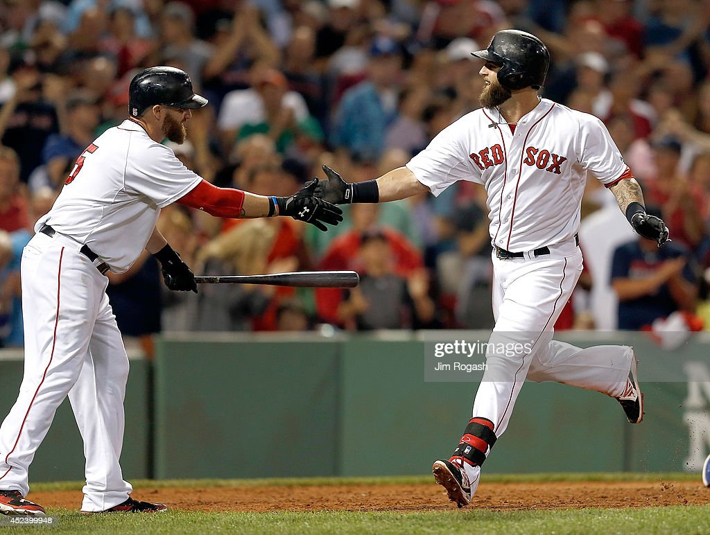 Mike Napoli #12 of the Boston Red Sox celebrates with Jonny Gomes #5 of the Boston Red Sox after he connected for a home run in the sixth inning against the Kansas City Royals at Fenway Park on July 19, 2014 in Boston, Massachusetts.
