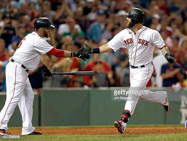 Mike Napoli of the Boston Red Sox celebrates with Jonny Gomes of the Boston Red Sox after he connected for a home run in the sixth inning against the...