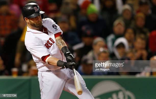 Mike Napoli of the Boston Red Sox connects for a grand slam in the fifth inning against the Oakland Athletics at Fenway Park on April 22, 2013 in...
