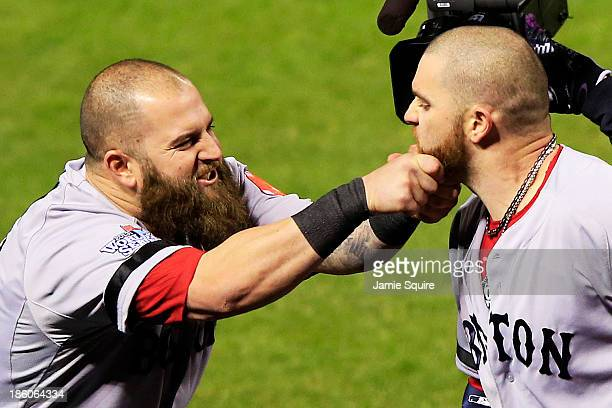 Mike Napoli of the Boston Red Sox pulls teammate Jonny Gomes beard after hitting a three run home run to left field against Seth Maness of the St...