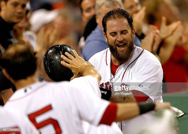 Mike Napoli of the Boston Red Sox reacts after he connected for a home run in the sixth inning against the Kansas City Royals at Fenway Park on July...