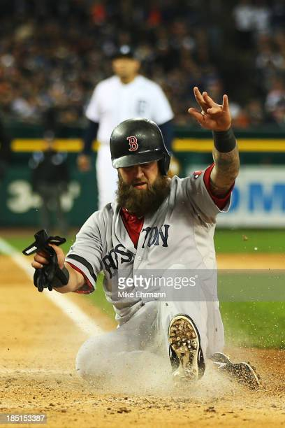 Mike Napoli of the Boston Red Sox scores on a wild pitch by Anibal Sanchez of the Detroit Tigers in the third inning of Game Five of the American...