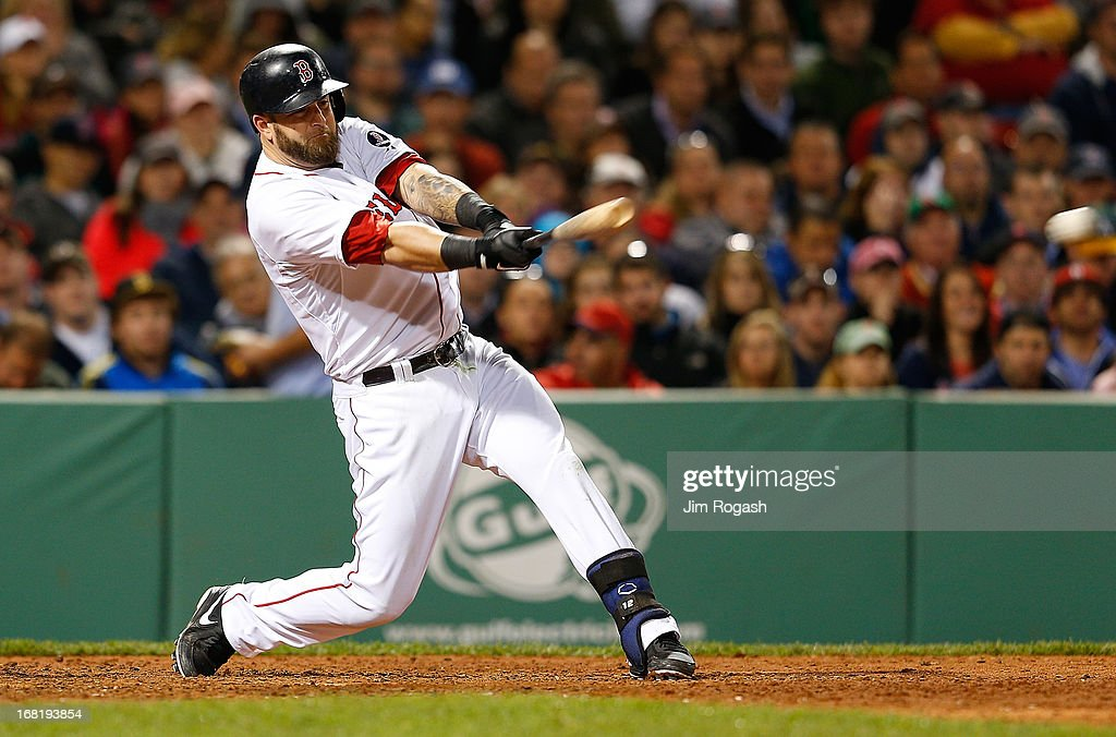 Mike Napoli #12 of the Boston Red Sox singles in a run against the Minnesota Twins in the 6th inning at Fenway Park on May 6, 2013 in Boston, Massachusetts.