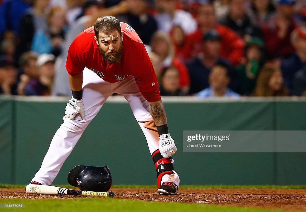 Mike Napoli #12 of the Boston Red Sox stands at home plate after striking out against the Detroit Tigers during the game at Fenway Park on May 16, 2014 in Boston, Massachusetts.