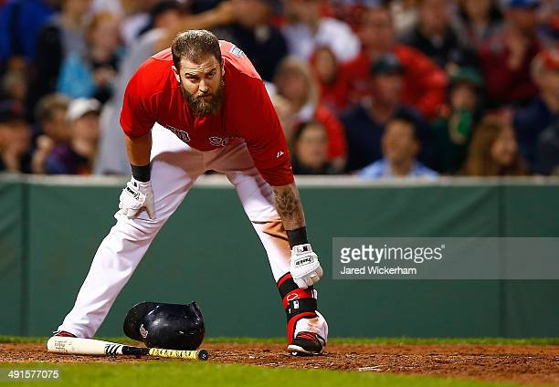Mike Napoli of the Boston Red Sox stands at home plate after striking out against the Detroit Tigers during the game at Fenway Park on May 16 2014 in...