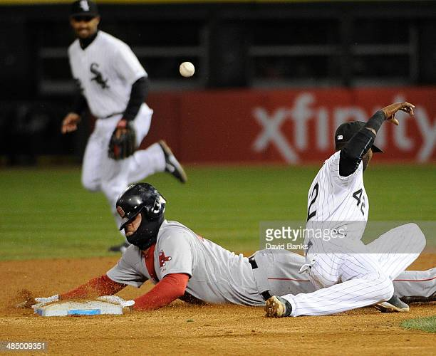 Mike Napoli of the Boston Red Sox steals second base as Alexei Ramirez of the Chicago White Sox tries to tag him during the ninth inning on April 15...