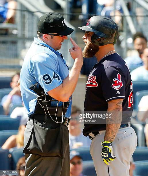 Mike Napoli of the Cleveland Indians argues with home plate umpire Lance Barrett after striking out in the eighth inning against the New York Yankees...