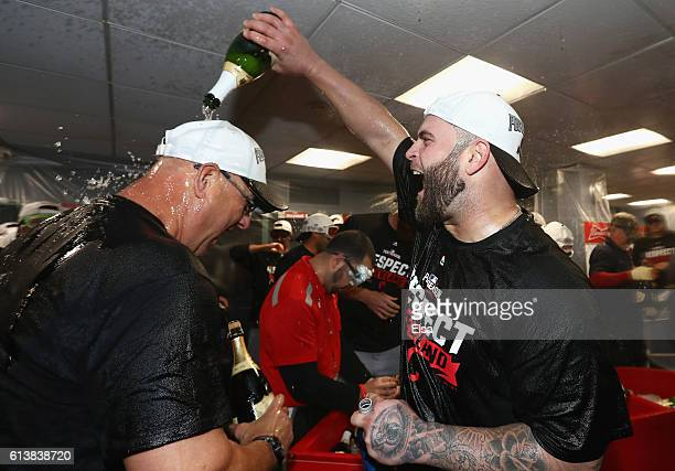 Mike Napoli of the Cleveland Indians celebrates with manager Terry Francona in the clubhouse after defeating the Boston Red Sox 43 in game three of...