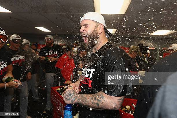 Mike Napoli of the Cleveland Indians celebrates with teammates in the clubhouse after defeating the Boston Red Sox 43 in game three of the American...