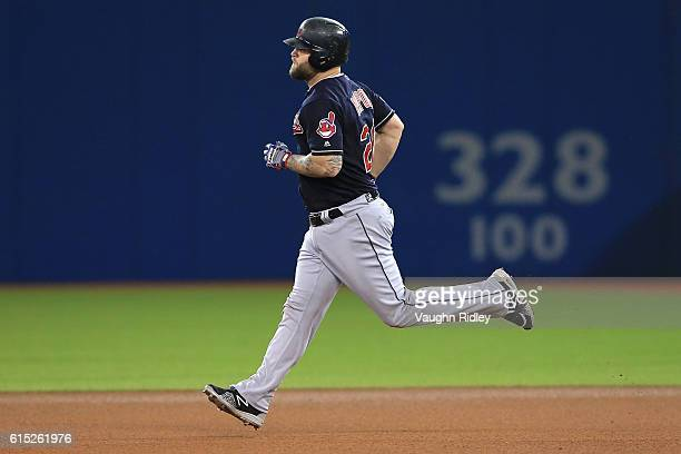 Mike Napoli of the Cleveland Indians rounds the bases after hitting a solo home run in the fourth inning against Marcus Stroman of the Toronto Blue...