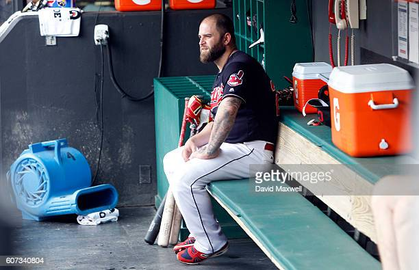 Mike Napoli of the Cleveland Indians sits in the dugout before the start of the game against the Detroit Tigers at Progressive Field on September 17...