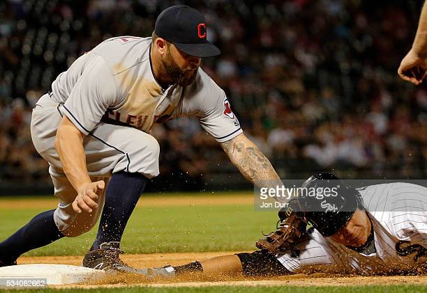 Mike Napoli of the Cleveland Indians tags out Avisail Garcia of the Chicago White Sox for the second out of a double play to end the fourth inning at...