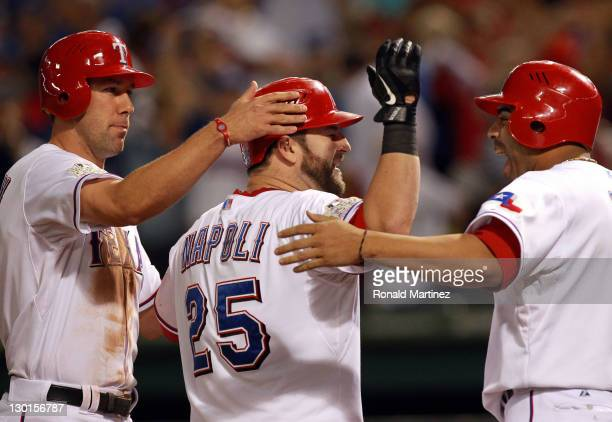Mike Napoli of the Texas Rangers celebrates with Nelson Cruz and David Murphy after a Napoli threerun home run in the sixth inning during Game Four...