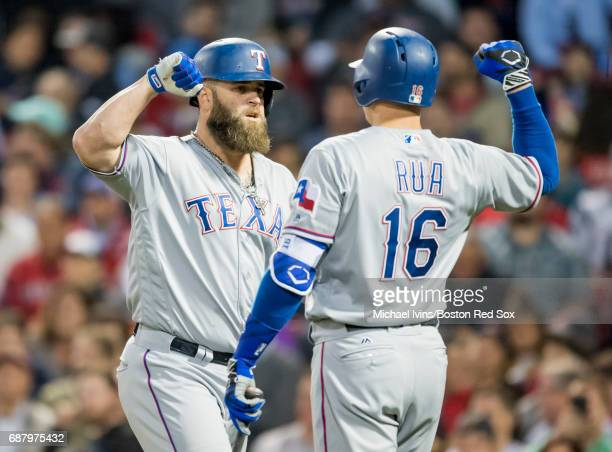 Mike Napoli of the Texas Rangers celebrates with Ryan Rua after hitting a home run against the Boston Red Sox in the fifth inning at Fenway Park on...