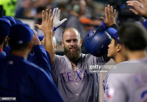 Mike Napoli of the Texas Rangers celebrates with teammates after hitting a solo home run against the Detroit Tigers during the fifth inning at...