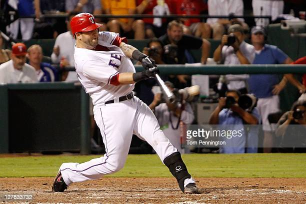 Mike Napoli of the Texas Rangers hits a tworun RBI single in the fourth inning of Game Two of the American League Division Series against the Tampa...