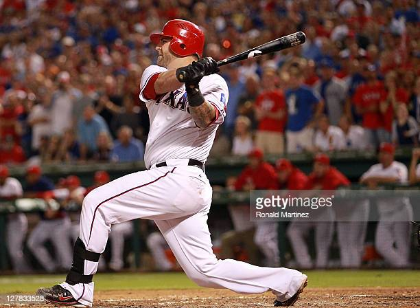 Mike Napoli of the Texas Rangers hits a tworun single against the Tampa Bay Rays in the 4th inning during Game Two of the American League Division...