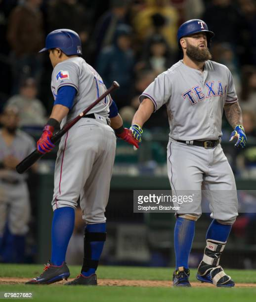 Mike Napoli the Texas Rangers right is congratulated by ShinSoo Choo of the Texas Rangers after Napoli hit a solo home run off of relief pitcher Dan...
