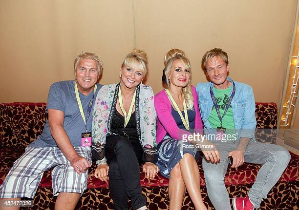 Mike Nolan Cheryl Baker and Jay Aston of Bucks Fizz performs backstage at Rewind Festival Scotland at Scone Palace on July 19 2014 in Perth United...