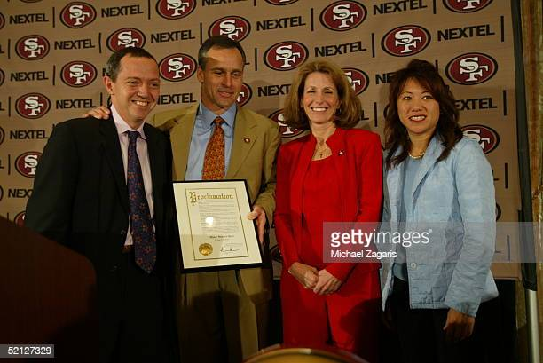 Mike Nolan is announced as the Head Coach of the San Francisco 49ers alongside Bevan Duffy and Kathy Nolan at the Mark Hopkins Hotel in San Francisco...