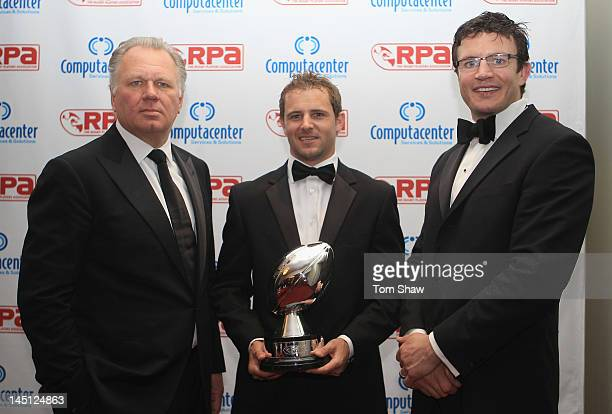 Mike Norris of Computacentre and Nick Evans of Harlequins and Martin Corry pose with the Computacentre Players Player of the Year Award during the...