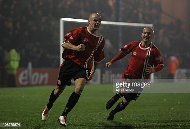Mike Norton of FC United of Manchester celebrates after scoring the winning goal during the FA Cup 1st Round match sponsored by eon at Spotland...