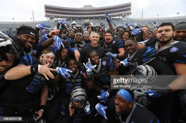 Mike Norvell, head coach of the Memphis Tigers celebrates after the game with his players against the Houston Cougars during the second half on...