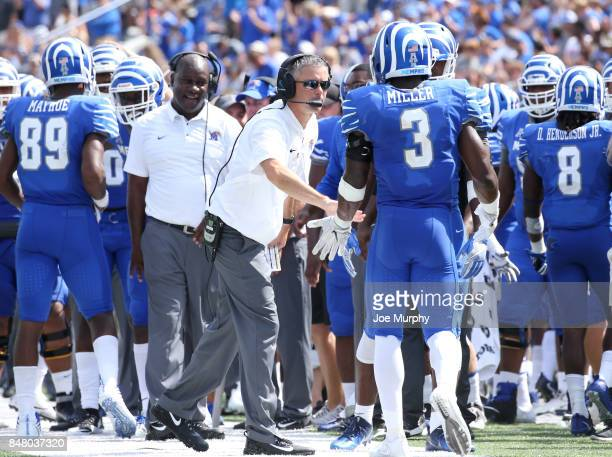 Mike Norvell head coach of the Memphis Tigers celebrates with Anthony Miller # of the Memphis Tigers after a touchdown against the UCLA Bruins on...