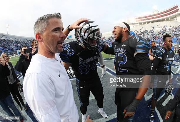 Mike Norvell head coach of the Memphis Tigers celebrates with Daniel Montiel and Trevon Tate of the Memphis Tigers against the Houston Cougars on...