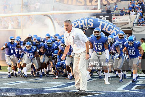 Mike Norvell head coach of the Memphis Tigers leads his team on the field before a game against the Kansas Jayhawks on September 17 2016 at Liberty...