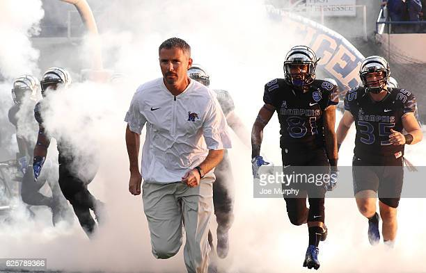 Mike Norvell Head coach of the Memphis Tigers leads his team on the field against the Houston Cougars on November 25 2016 at Liberty Bowl Memorial...
