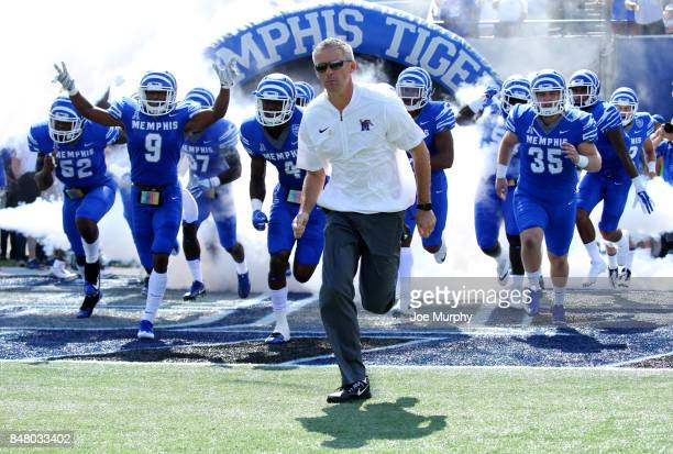 Mike Norvell head coach of the Memphis Tigers leads his team on the field before a game against the UCLA Bruins on September 16 2017 at Liberty Bowl...