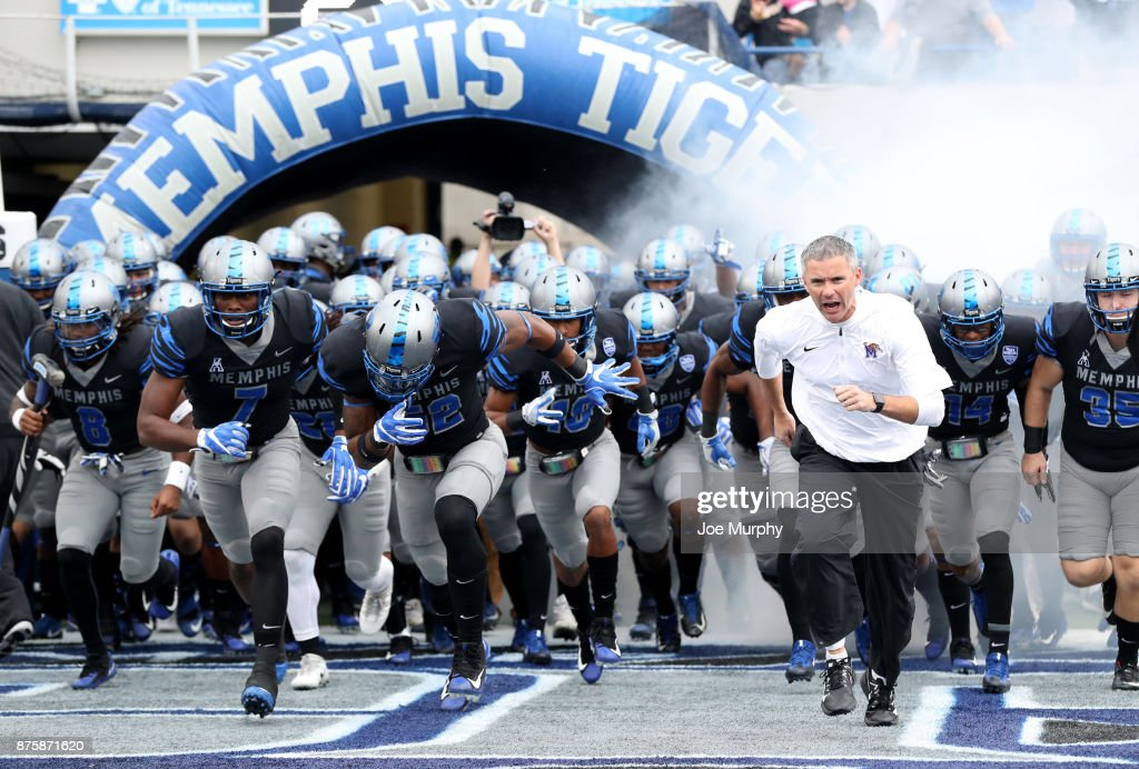 Mike Norvell, Head coach of the Memphis Tigers leads his team on the field before a game against the SMU Mustangs on November 18, 2017 at Liberty Bowl Memorial Stadium in Memphis, Tennessee.