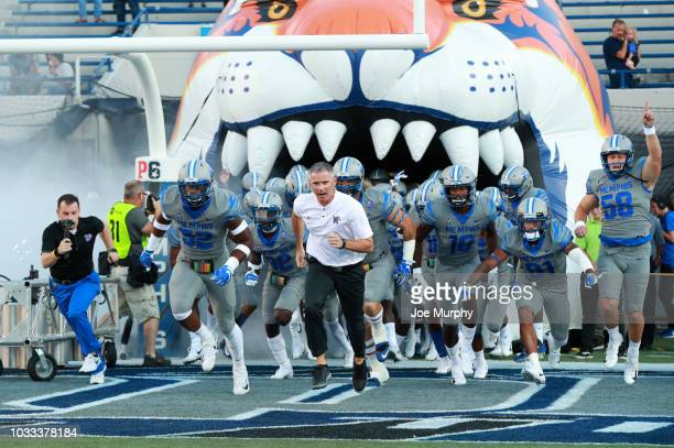 Mike Norvell head coach of the Memphis Tigers leads his team on to the field against the Georgia State Panthers on September 14 2018 at Liberty Bowl...