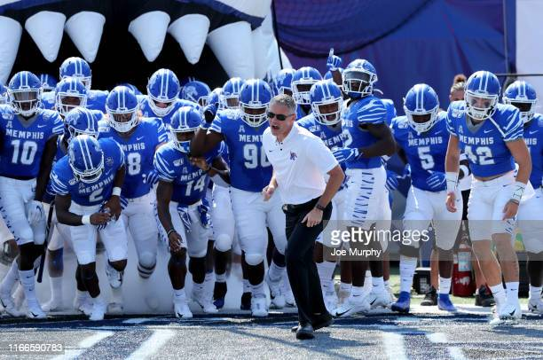 Mike Norvell head coach of the Memphis Tigers leads his team on to the field against the Southern Jaguars on September 7 2019 at Liberty Bowl...