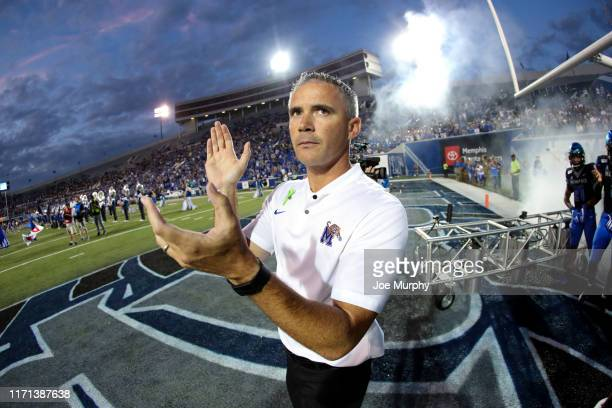 Mike Norvell head coach of the Memphis Tigers prepares to lead his team on the field before a game against the Navy Midshipmen on September 26 2019...