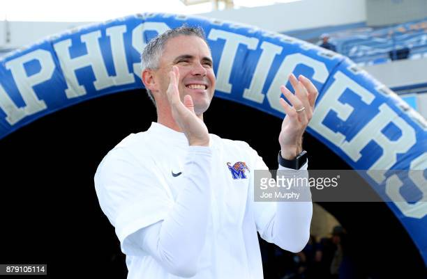 Mike Norvell head coach of the Memphis Tigers smiles and claps before the game against the East Carolina Pirates on November 25 2017 at Liberty Bowl...