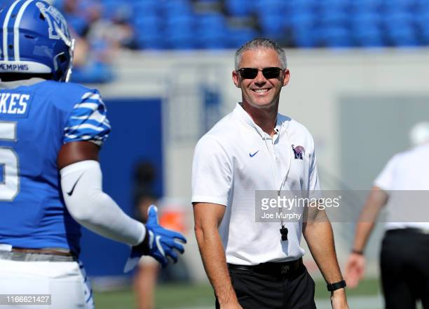 Mike Norvell head coach of the Memphis Tigers smiles before a game against the Southern Jaguars on September 7 2019 at Liberty Bowl Memorial Stadium...
